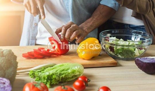 Black man preparing vegetable salad : Stock Photo