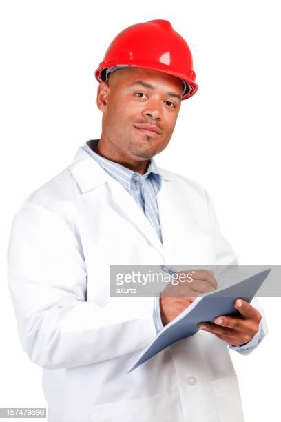 Black man red hard hat white lab coat writing isolated