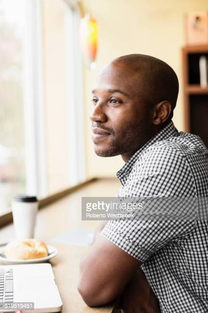 Black man relaxing in coffee shop