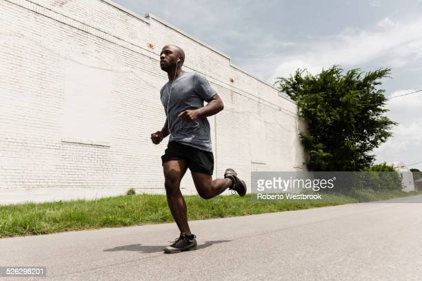 Black man running on city street