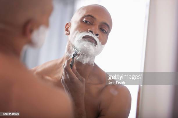 Black man shaving
