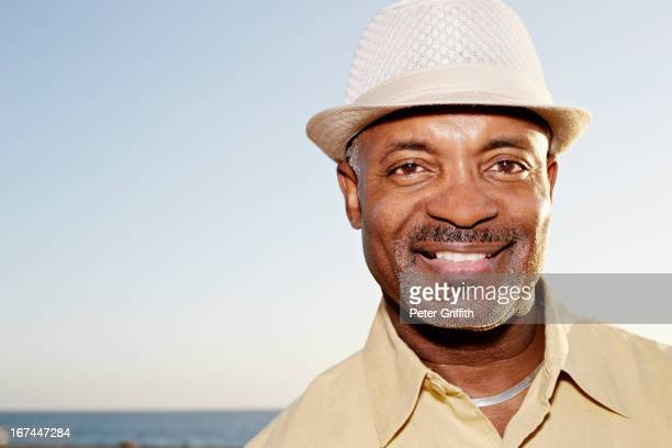 Black man smiling outdoors