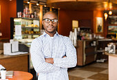 Black man standing in coffee shop
