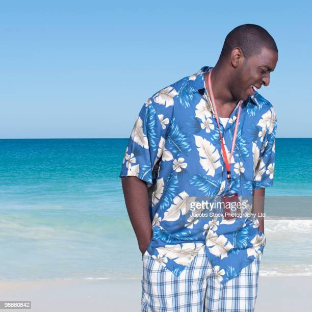 Black man standing on tropical beach
