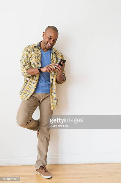 Black man using cell phone