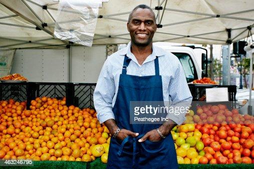 Black man working at outdoor market
