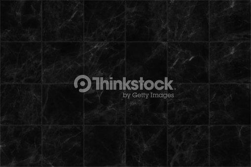 Pavimento di piastrelle in marmo nero seamless texture per il