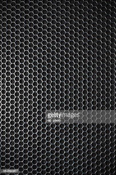 Black metal mesh background made up of hexagons