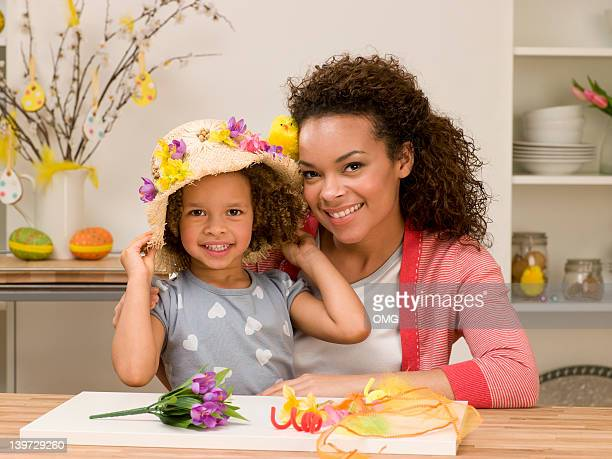 Black mother and child with Easter bonnet