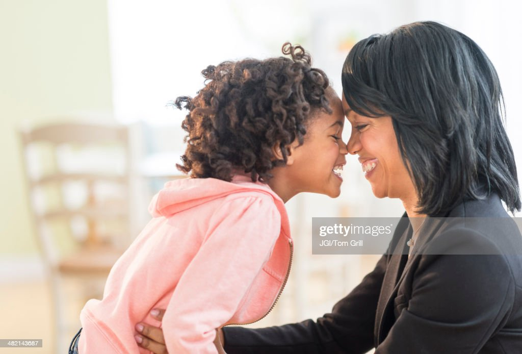 Black mother and daughter rubbing noses