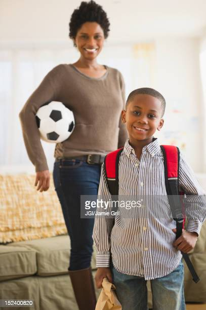 Black mother and son getting ready for the day