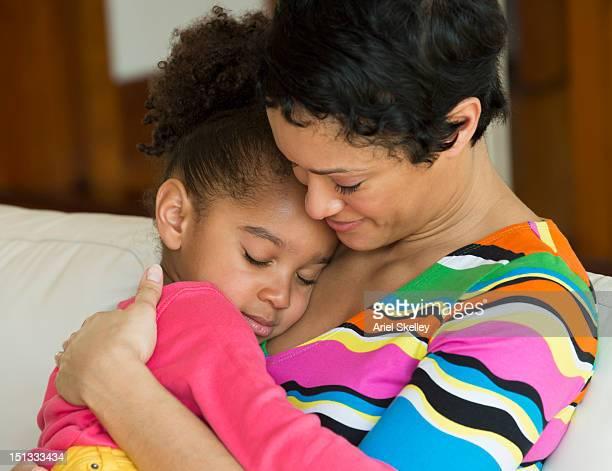 Black mother comforting daughter
