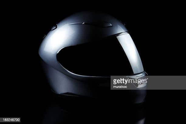 Black motorcycle helmet on a black background