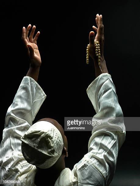 Black muslim man praying