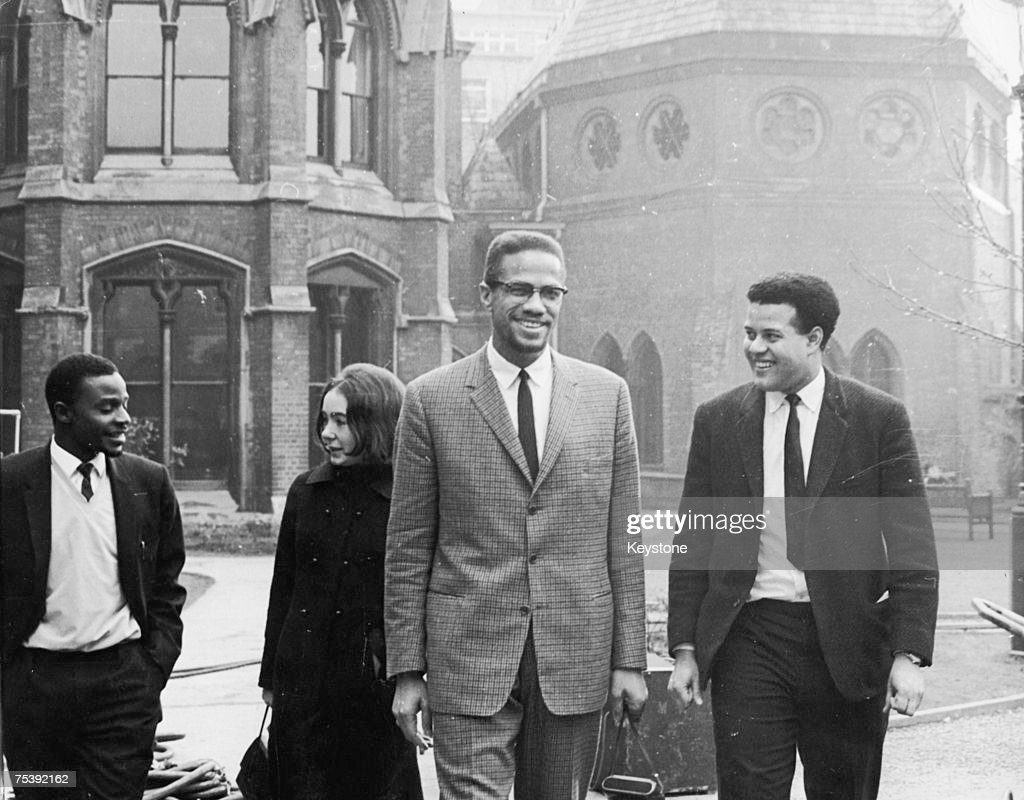 Black Nationalist leader and Nation of Islam spokesman <a gi-track='captionPersonalityLinkClicked' href=/galleries/search?phrase=Malcolm+X&family=editorial&specificpeople=70045 ng-click='$event.stopPropagation()'>Malcolm X</a> in Oxford with Eric Abrahams, right, the Student Union president, before addressing university students on the subject of extremism and liberty, 3rd December 1964.