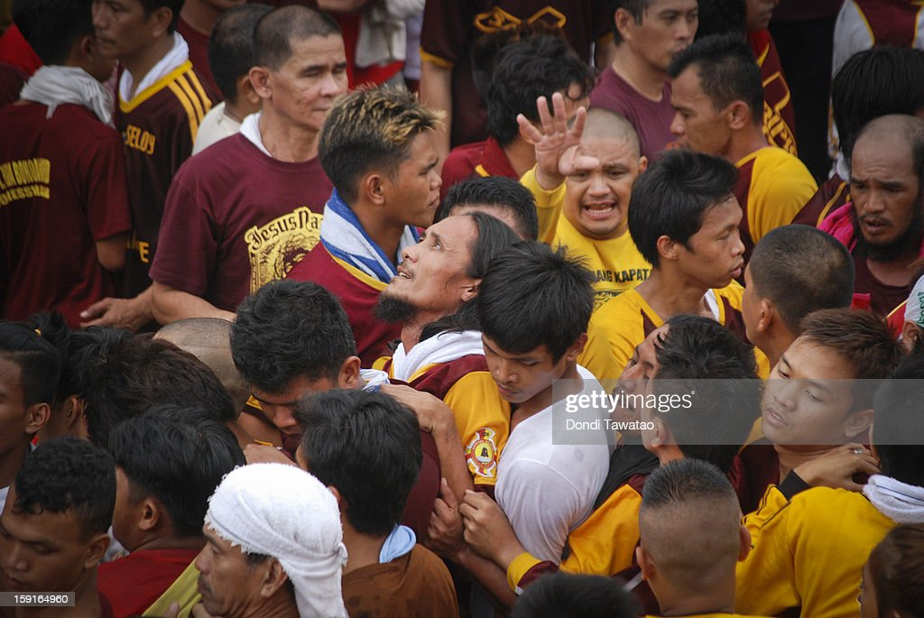 Black Nazarene devotees jostle with one another to touch the rope tugging the Black Nazarene, during the 406th feast of The Black Nazarene on January 9, 2013 in Manila, Philippines. Devotees march barefoot as a sign of sacrifice during the procession as the Black Nazarene is carried in turn through Manila's thouroughfares. The dark wood sculpture of Jesus was brought to the Philippines in the 1600s during the Spanish colonization of the Philippines and is revered by Catholic devotees who claim the statue possess miraculous powers.