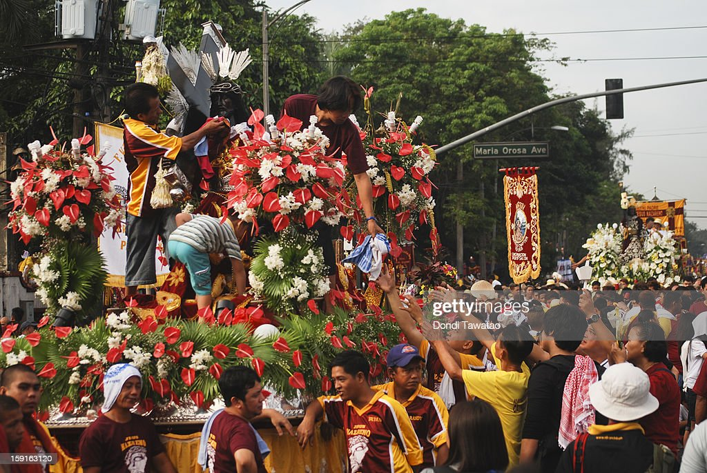 Black Nazarene replicas join the parade of millions of Catholic devotees converging in Quiapo for the 406th feast of The Black Nazarene on January 9, 2013 in Manila, Philippines. Devotees march barefoot as a sign of sacrifice during the procession as the Black Nazarene is carried in turn through Manila's thouroughfares. The dark wood sculpture of Jesus was brought to the Philippines in the 1600s during the Spanish colonization of the Philippines and is revered by Catholic devotees who claim the statue possess miraculous powers.