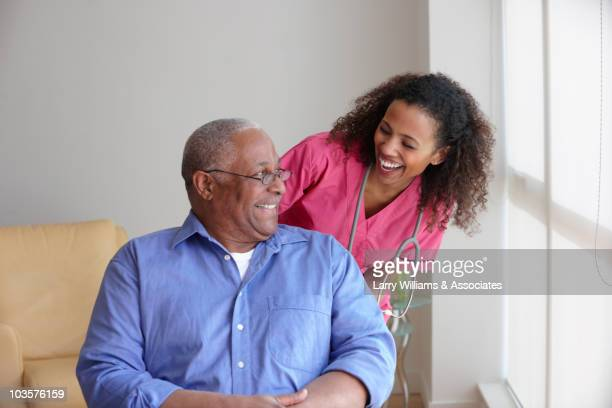 Black nurse caring for patient