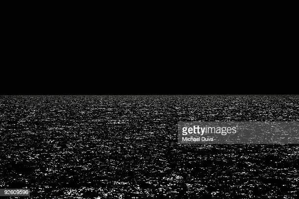 black ocean horizon with moonlight reflecting