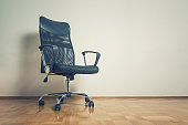 Black office chair in empty room. Business interior background.