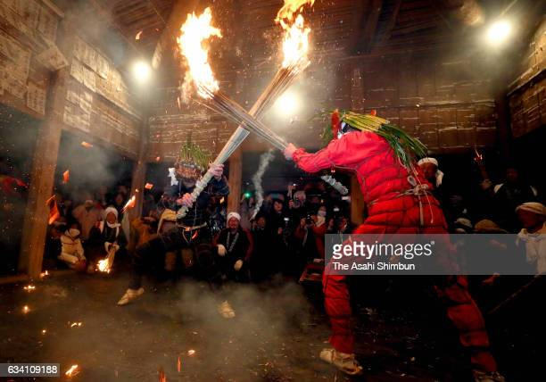 Black ogre or Shizume Oni and red ogre or Saibara Oni holding torches dance in the hall during Shujo Onie to celebrate the coming of spring and wish...