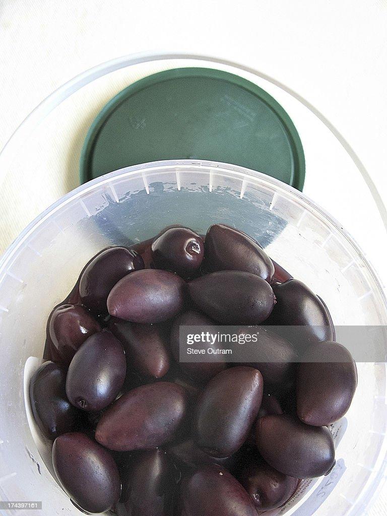 Black olives in plastic container. Crete, Greece : Stock Photo