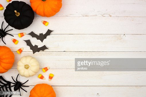 Black, orange and white Halloween side border over white wood : Stock Photo