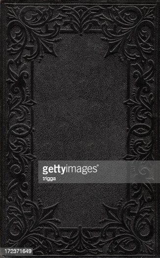 Embossing Fabric Book Cover : A black ornately embossed book cover stock photo getty