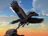 A black coated pegasus launches itself into the winds from the very top of a rocky mountain. This mythical flying horse takes flight. 3D Rendering.