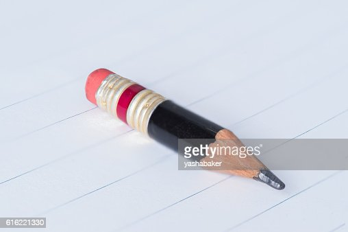 Black pencil with pink eraser on a paper : Stock-Foto