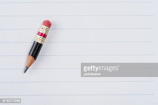 Black pencil with pink eraser on a paper : Foto stock