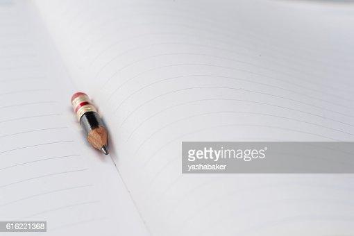 Black pencil with pink eraser on a paper : Bildbanksbilder