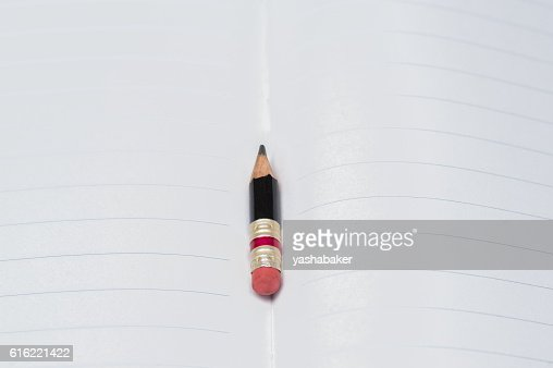 Black pencil with pink eraser on a paper : Stock Photo