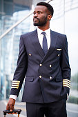 Black person pilot walking at the airport