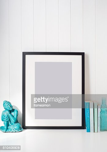 Black picture frame on desk : Stock Photo
