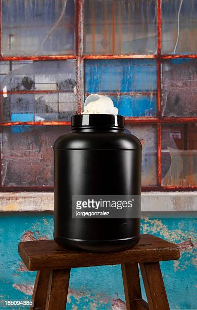 Black plastic container with protein powder