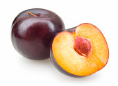 black plums isolated on white background