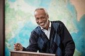 Black professor smiling at podium
