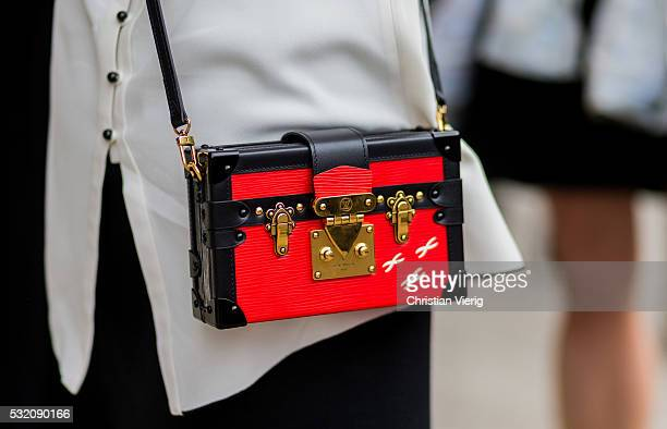 A black red Louis Vuitton bag outside Emma Mulholland at MercedesBenz Fashion Week Resort 17 Collections at Carriageworks on May 18 2016 in Sydney...