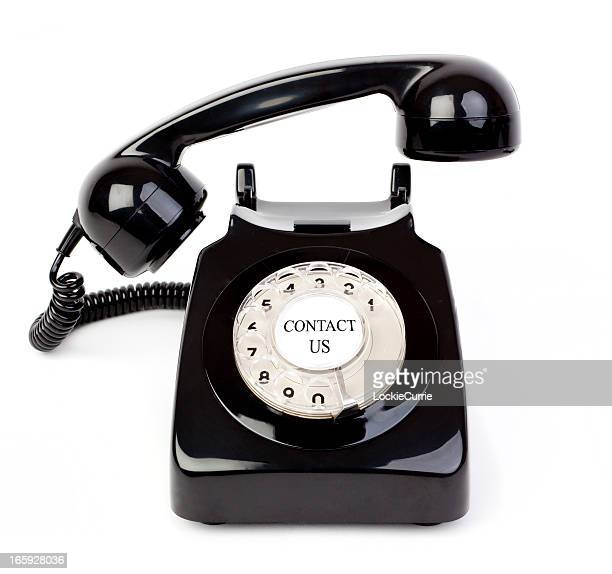 Black retro dial phone with contact us written on center