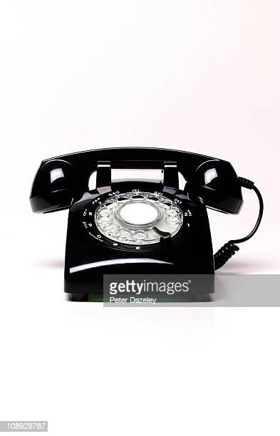 Black retro telephone with copy space
