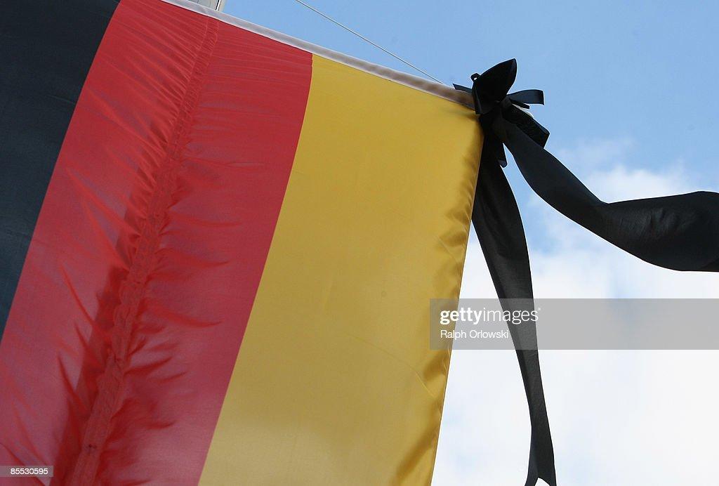 A black ribbon is fixed at a German flag downtown Winnenden on March 20 2009 in Winnenden near Stuttgart Germany 17 year old Tim Kretschmer opened...