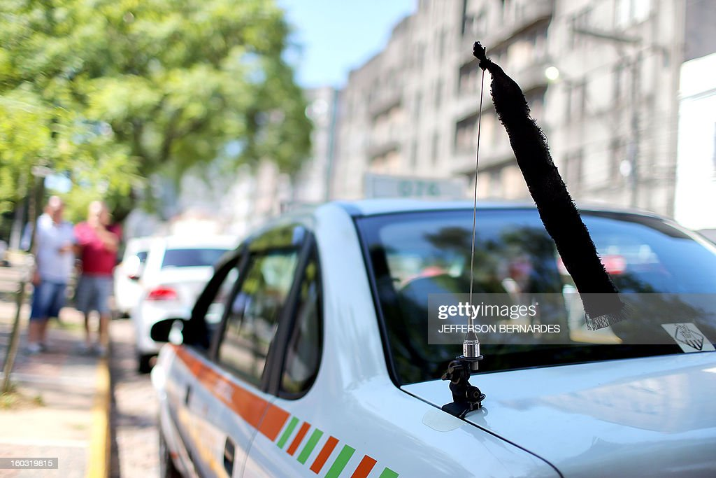 A black ribbon is tied to the antenna of a taxi in Santa Maria, southern Brazil on January 29, 2013 during the three-day period of official mourning decreed after the tragedy occured in the Kiss nightclub that left a death toll of over 230. Police in Brazil arrested four suspects Monday after a nightclub fire killed 231, left dozens more clinging to life, and forced officials to defend readiness for the Olympics and World Cup.