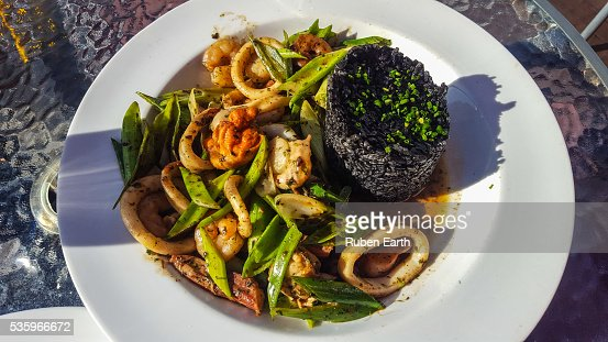 Black Rice with squid and vegetables : Stock Photo