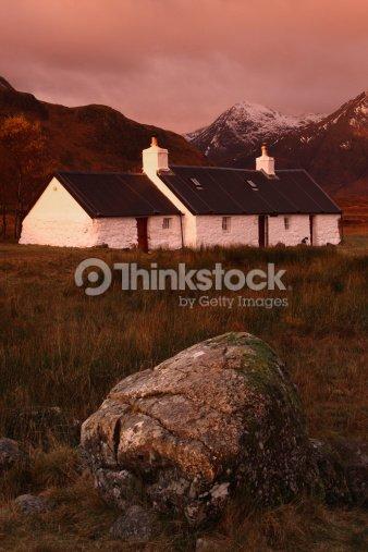 Black Rock Cottage Rannoch Moor Scottish Highlands At Sunrise Stock Photo