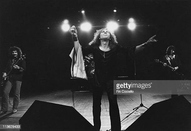 Black Sabbath bassist Geezer Butler singer Ronnie James Dio and guitarist Tony Iommi on stage during a live concert performance at the Gaumont in...