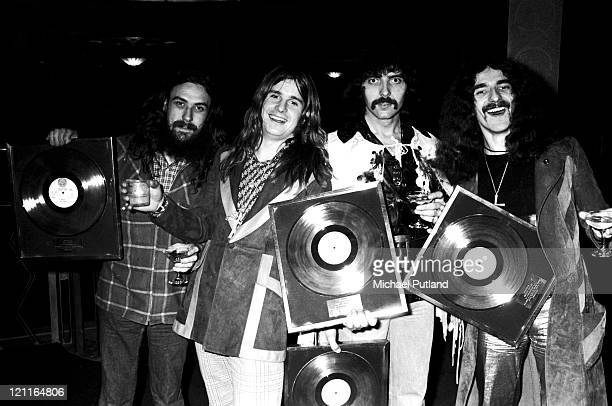 Black Sabbath pose for a group portrait with gold discs London LR Bill Ward Ozzy Osbourne Tony Iommi Geezer Butler
