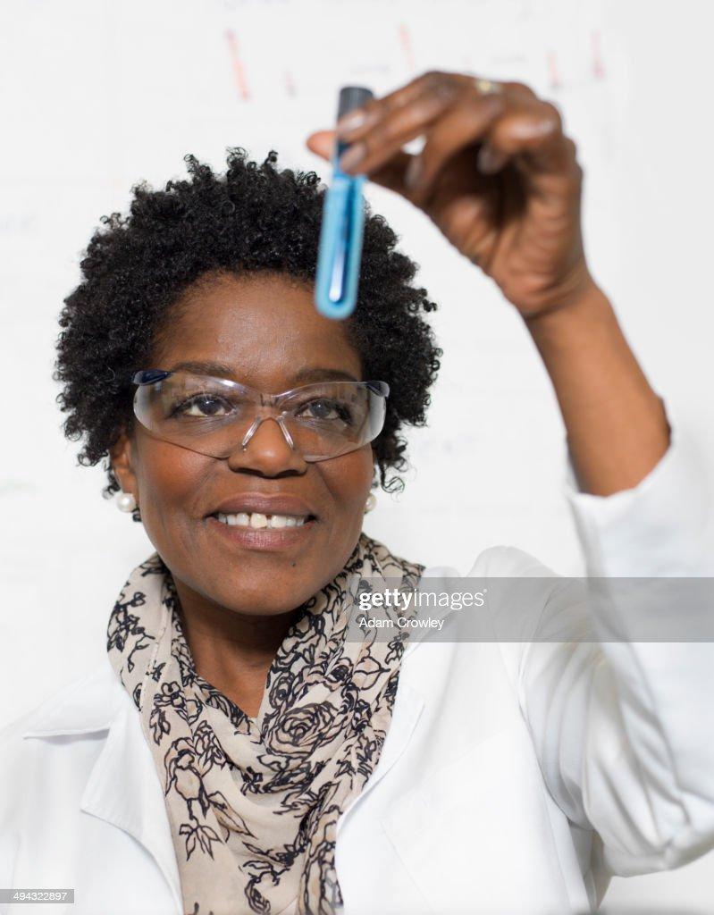 Black scientist examining sample in lab : Stock Photo