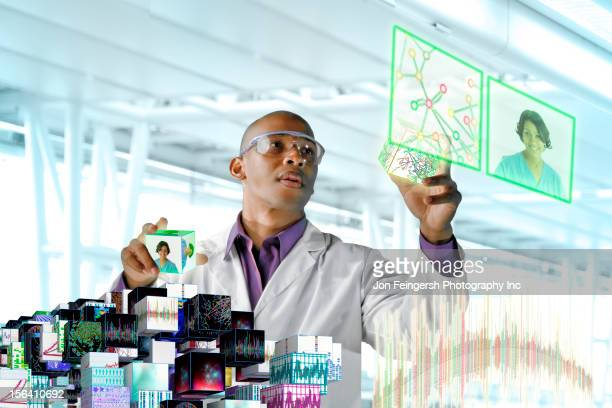 Black scientist working with scientific images