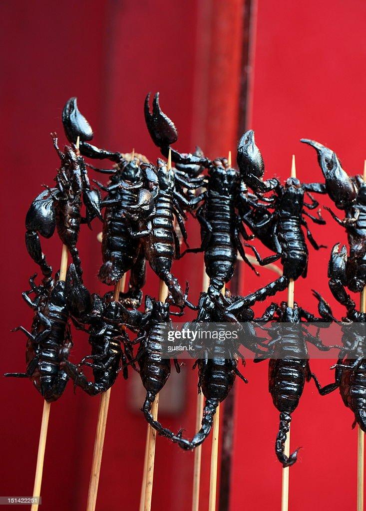 Black scorpions on stick